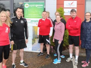 Michell Greaney, Optimal Fitness, with runners from Aspen Grove. Photo by Dermot Crean