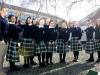 Hanging painted eggs on a tree at Presentation Tralee were German teacher Marian Cronin with pupils Palesa Hlongwane, Michelle Miranda, Bronagh Kelliher, Sarah Horan, Alice O'Connell, Amy McCarthy, Ellie O'Hanlon, Ria Harmon and Sadhbh Lowth and Ellie Mason. Photo by Dermot Crean