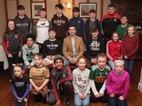 Aidan O'Mahony with members of the Under 15 boys and Under 12 girls teams who were presented with medals on Friday evening at The Station House. Photo by Dermot Crean