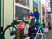 Students from Kerry College of Further Education, Eugenia Rodina, Bernie Kinch and Clodagh Byrne, at work on the mural at Milk Market Lane. Photo by Dermot Crean