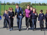 Minister Brendan Griffin is joined by local athlete Shona Heaslip and pupils from Blennerville, Caherleaheen, Listellick and CBS Primary schools at the launch of 'The Daily Mile' at St Brendan's NS Blennerville on Friday morning. Photo by Dermot Crean