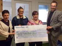 Jackie McCull (left) and Angela Hickey (second right) of the Cashel Ward at UHK accept a cheque from Kelly Sheahan and David Scott of Tralee Chamber Alliance.
