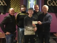 Michael O'Sullian accepting the cheque on behalf o his grandfather, Mike O'Brien who won top prize in the March Monthly Club Draw..Also in photo, Aidan Behan - Chairperson, Tom Rice - Promoter, Mike O'Mahoney - Treasurer.