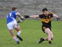 Barry John Keane gets past David Naughton in the Kerins O'Rahillys v Dr Crokes match on Sunday in Strand Road. Photo by Dermot Crean