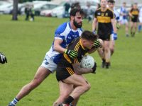 Cormac Coffey tackles Micheal Burns in the Kerins O'Rahillys v Dr Crokes match on Sunday in Strand Road. Photo by Dermot Crean