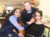 Jemi John and Saoirse Horgan apply the effects make-up to Orla O'Brien during the special make-up art event on Wednesday at Presentation School. Photo by Dermot Crean
