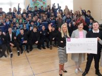 Principal of St Ita's and St Joseph's, Grace Sheehan, accepts a cheque for €3,000 from Fiona Hyde and Liane Dee of the fashion show committee. Also in front is Fiona's son Dylan with the students and staff in the back. Photo by Dermot Crean