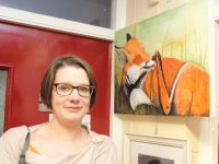 Kate Sheehan with her painting at the exhibition of art from night classes students at Coláiste Gleann Lí on Thursday evening. Photo by Dermot Crean