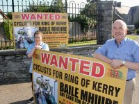 Baile Mhuire Healthcare Assistant Pauline O'Sullivan with Aidan Kelly and the superfluous sign. Photo by Dermot Crean