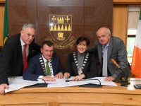 At the signing of the contact for 21 new housing units at Killeen were Charlie O'Sullivan KCC, Cathaoirleach of KCC John Sheahan, Mayor of Tralee Norma Foley and Ned O'Shea, Contractor.
