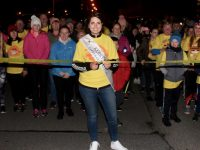 Kerry Rose Breda O'Mahony cuts the tape to start the Darkness Into Light walk from CBS The Green on Saturday morning. Photo by Dermot Crean