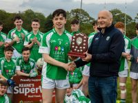 Fergal Barry Captain Na Gaeil Minors presented Plaque by Peter Twiss