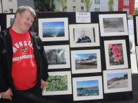 David Malone of Inspired with his photos on exhibit outside No.4 On The Square. Photo by Dermot Crean