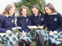 Looking at their 'time capsules' were Vivien Ahern, Anna Sheehy, Maebh Pierse and Amy Qejvani at the Presentation Secondary School Graduation Day on Friday. Photo by Dermot Crean