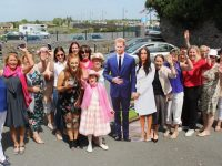The crowd joins Harry and Megan at the Royal Wedding day fundraiser in Skelper Quane's on Saturday. Photo by Dermot Crean