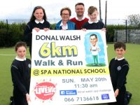 Spa NS pupils with Elma Walsh and Principal Peter Linehan launching the Donal Walsh 6km Walk/Run at the school on Thursday. Photo by Dermot Crean