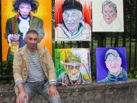 Local artist Mikel with portraits of music legend Jimi Hendrix and artist Francis Bacon as well as locals Willie Seeler, Christy McCarthy and James O'Brien. Photo by Dermot Crean
