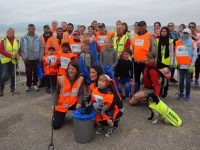 Volunteers in the clean-up on Banna Beach on Sunday.