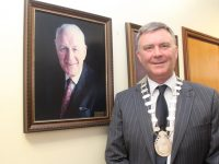 Mayor Graham Spring next to a photo of his late grandfather Dan Spring, a former Cathaoirleach of Kerry County Council. Photo by Dermot Crean