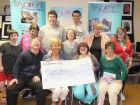 Kay McNamara of the Rosemary Day Centre, receives a cheque from Inspired. Photo by Dermot Crean