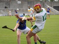 Jordan Brick gets his shot away despite Brendan Brosnan's efforts. Photo by Dermot Crean