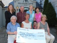 Maura Sullivan of Kerry Hospice Foundation (seated centre) receiving a cheque for €22,820 from Paddy and Peigí Ó Mahúna of The Meadowlands Hotel following their 20th Anniversary Festival in aid of Kerry Hospice. Also pictured, back row, from left is Siobhán O Mahúna, Meadowlands Hotel General Manager, Joe Hennebery, Mairead Fernane and Mary Shanahan with Sean Óg Pierce. Photo by Dermot Crean