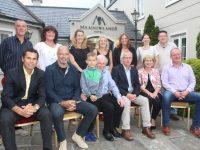 The Ó Mathúna family and friends at the Sports Gala night at the Meadowlands Hotel on Saturday. Front from left; Sean Óg Ó hAilpín, Paul McGrath,  Johnny Neillings, Paddy and Peigí Ó Mathúna,  and Mick Galwey. Back from left; Steve Neillings, Nuala Moore, Bríd Ní Mhathúna, Fionnuala Ní Mhathúna, Siobhan Ní Mhathúna, Maeve Ní Mhathúna and Tony Locke. Photo by Dermot Crean