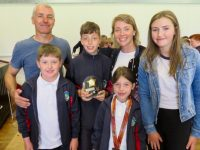 Tomás Kennedy, winner of the Scoil Eoin 'School Spirit Award', with his family. Photo: Carol Anne O'Donoghue