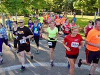 Participants take off at the Summer Solstice 10k Race from the Town Park on Thursday night. Photo by Dermot Crean
