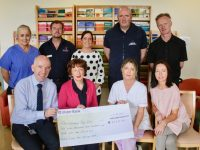 At the presentation of the cheque at the Chemotherapy Unit on Friday were, in front, General Manager of the UHK Fearghal Grimes, Mary Fitzgerald, Cora Walsh and Teresa Walsh. At back; Margaret Jones, Joseph Diggins, Therese Carroll, Paul McCarthy and Sean O'Dowd. Missing from photo is Mairead Enright. Photo by Dermot Crean