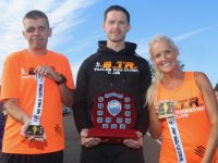 Liam Horan, Tom Foley and Marilyn O'Shea of the Born To Run Club with the shield and medals from the 40 Mile Ultra Marathon. Photo by Dermot Crean
