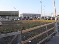 Cars parked on the vacant site opposite Austin Stack Park on a match day.