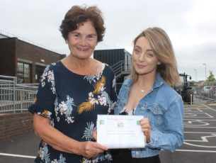 Mary Shanahan accepts the proceeds of a fundraiser by Bláthnaid Buckley, the granddaughter of the late Ted Moynihan, the driving force behind Kerry Hospice for so many years. Photo by Dermot Crean