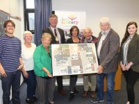 Johnnie Wall making a presentation to the late Tommy O'Connor's family at the launch of the Mitchels Boherbee Regeneration Group Exhibition at Tralee Library. Included are, from left; Rory O'Connor, Angela Walsh, Anne O'Connor, Mayor of Tralee Graham Spring, Tracy Dowling, Jimmy Smith, Johnnie Wall and Shannon Dowling. Photo by Dermot Crean