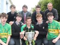 The Neilus Flynn trophy visits Gaelcholáiste Chiarraí. Included is Sean Ó Cíosáin, Liam de Staic, Ruairi MacAmhlaoibh and Eoin de Staic. Darren Ó Briain, Principal Ruairí Ó Cinnéide, Aodáin Ó Seanachain and teacher Fearghus Mac Muiris who is manager of the Lixnaw team. Photo by Dermot Crean
