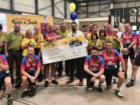 Woodies Tralee Manager, Tadhg O'Regan, presents the cheque for €6,001 to Woodies CEO Declan Ronayne on Monday. Also included are Woodies Tralee staff and the Woodies Heroes Cyclists.