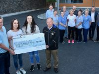 At the presentation of the proceeds of the Robert O'Dowd Memorial 5/10k event were, front, Eoin Kelliher, Sandra O'Dowd, Fiona O'Dowd and Joe Hennerbery. At back; Karl Keohane, Linda O'Connor, Ellie Laverty, Timmy O'Dowd, Michelle Greaney, Martin Dennehy, Lorraine McCarthy, Eileen Horan, Matt Moloney and Tommy O'Dowd. Photo by Dermot Crean