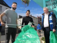 John Fitzgerald and Zoe O'Mahony of Wild Cafe with Tim O'Connor of Tralee Chamber Alliance taking part in the GLAN two-minute clean-up on Friday. Photo by Dermot Crean