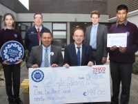 Janusz Glebocki, Store Manager at Tesco in the town centre, presents a cheque for €199 to Principal of Coláiste Gleann Lí, Richard Lawlor. Also included is student Hannah Mullins, Duty Manager at Tesco Sean Fitzgerald, Deputy Principal Liam McGill and student Zain Ali. Photo by Dermot Crean