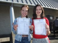 High-achieving Mercy Mounthawk students Keela Hughes (nine A grades) and Isobel Keane (eight A grades) with their results on Wednesday morning. Photo by Dermot Crean