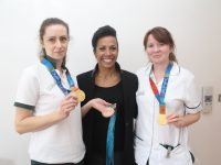 Kelly Holmes with occupational therapists Bridget Scannell and Siobhan O'Grady trying on her Olympic medals at the Palliative Care Unit on Thursday. Photo by Dermot Crean