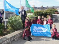 Moyderwell Mercy Principal Moira Quinlan and Sean Kelly raise the Erasmus flag at the school. Photo by Dermot Crean