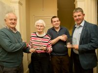 Christy Lynch (Area Manager SVP) presenting a special trophy to Honor O'Connor to mark 50 years as a volunteer SVP and incoming president Tralee and South West Area Paddy Kevane presenting Junior Lock outgoing President SVP with a special trophy.