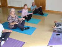 Maeve Ferris (right) teaching a yoga class to Treasa Walsh, Marian Moore, Rebecca McDaid and Dan Fleming at Shanakill Resource Centre on Tuesday. Photo by Dermot Crean