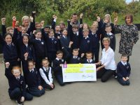 Maura Sullivan and Nuala Finnegan of Kerry Hospice collected a cheque from Caherleaheen NS pupils on Thursday morning. Also included are teachers Brid Murphy and Damien Finn and Principal Mary Connolly. Photo by Dermot Crean