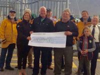 Kevin Williams presenting a cheque to members of Fenit RNLI.