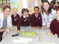 Teachers Claire Dempsey and Linda Hanafin with senior infants taking part in Maths Week at Holy Family on Monday. Photo by Dermot Crean