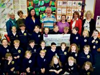 Gaelscoil Mhic Easmainn teachers and pupils with Dan Galvin of Kerry Hospice at the cheque presentation.