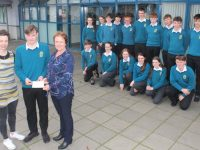 Mercy Mounthawk student Cillian Griffin presents a cheque to Elma Walsh of the Donal Walsh LiveLife Foundation, the proceeds of the basketball match between teachers and pupils. Also pictured is teacher Olivia Dineen and TY students. Photo by Dermot Crean