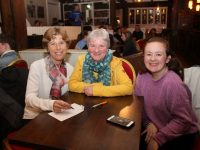 Bríd Uí Chatháin, Cáit Uí Luanaigh and Michaela McCarthy at the Table Quiz as gaeilge  Iin The Ashe Hotel on Wednesday evening. Photo by Dermot Crean